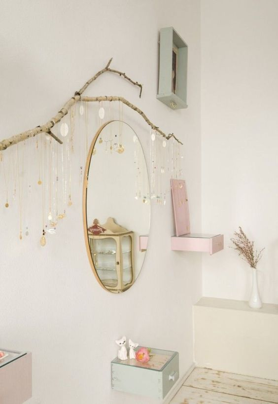 a large branch attached to the wall serves as a cool natural jewelry holder - what a lovely solution for a girl's room