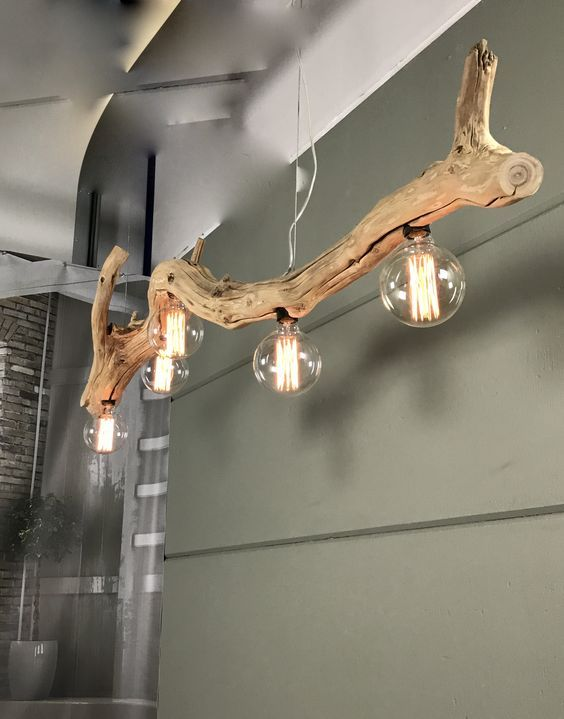 a large driftwood branch turned into an ultra-modern and super stylish pendant lamp