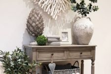 a large heart wall decor made of whitewashed driftwood branches is a cool beach and coastal idea