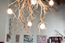 a statement chandelier made of gorgeous tree branches and bulbs is a fantastic feature for your home