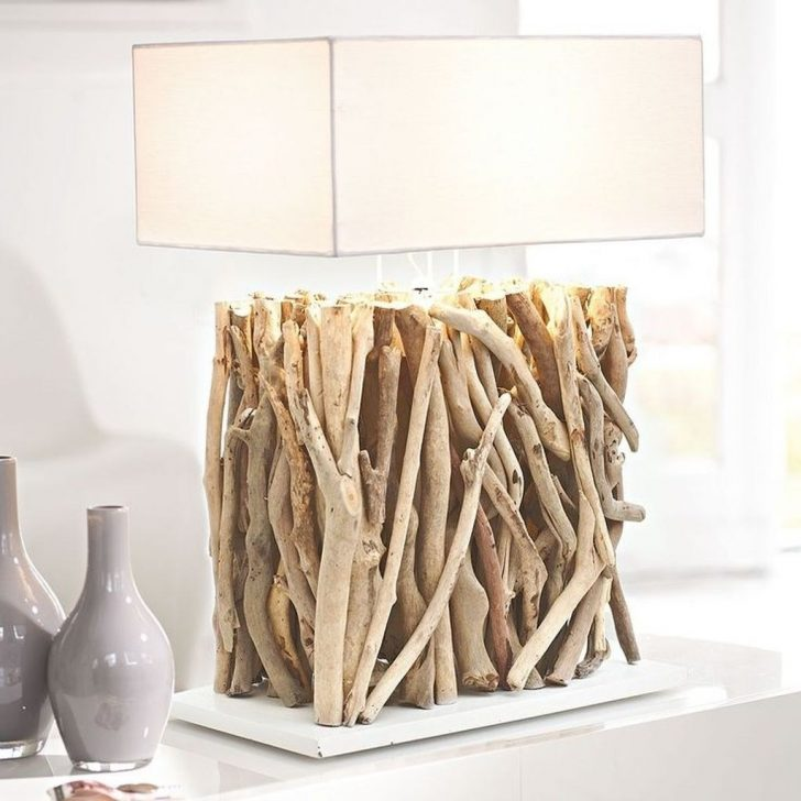a table lamp with a driftwood base and an elegant square lampshade is a very contrasting and cool combo