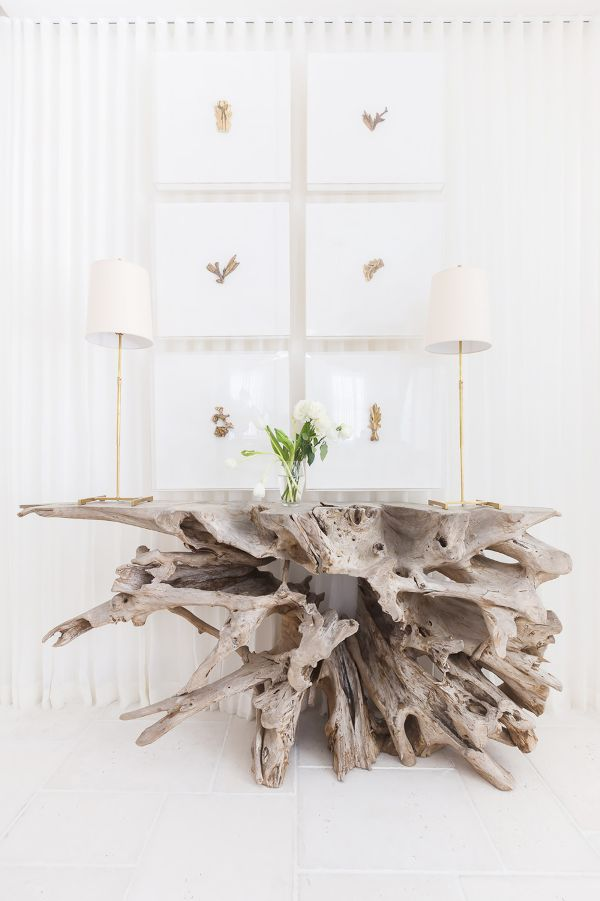 a whimsy console table of driftwood is a perfect statement piece for your beach home entryway