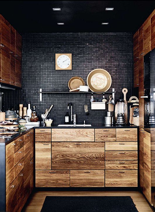black works so well with rustic wood on this gorgeous yet compact kitchen