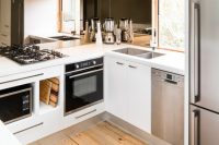 glossy white works well with natural wood in any kitchen design