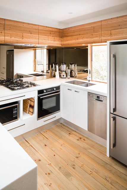 Fancy glossy white works well with natural wood in any kitchen design