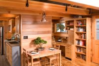houseboat rustic kitchen that is well connected with other rooms