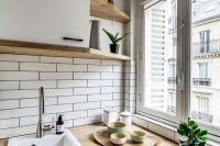 tiny parisian apartments usually have small kitchens that look beauitful anyway