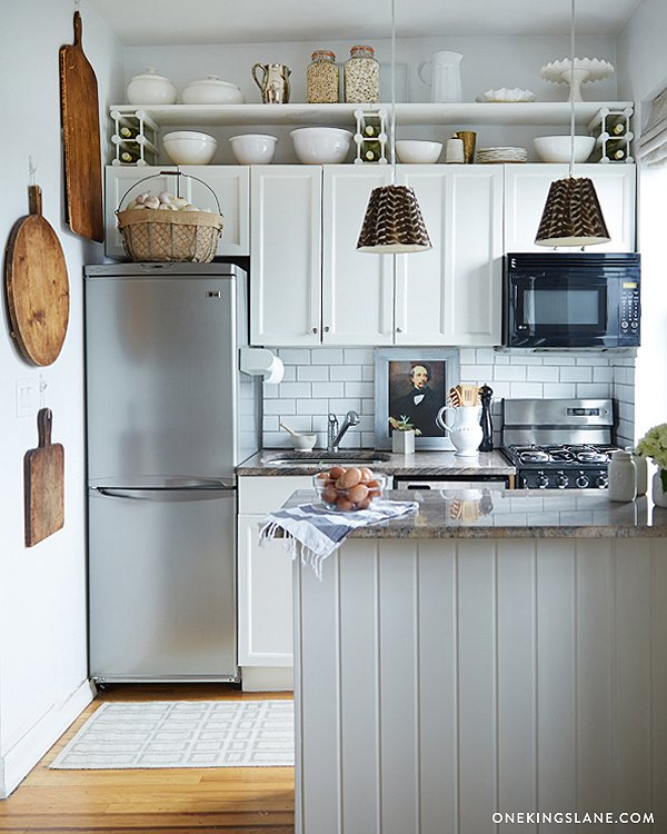 traditional kitchen cabinets meet modern appliances on this cozy kitchen