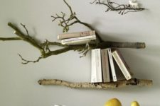 wall-mounted shelves made of branches are a cool and chic idea to rock in your home – no special decor is needed