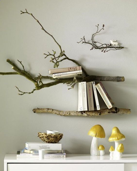 wall-mounted shelves made of branches are a cool and chic idea to rock in your home - no special decor is needed