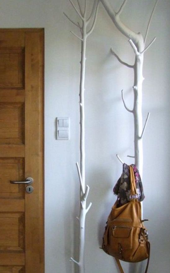 whitewashed trees in the entryway can work as holders and hangers for all kinds of stuff and clothes