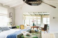 who could thought that an old wooden boat could become a part of a bedroom ceiling decor