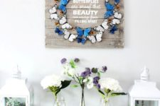 a chic artwork of a colorful buttefly wreath and white letters is a cool idea to bring a touch fo spring to the space