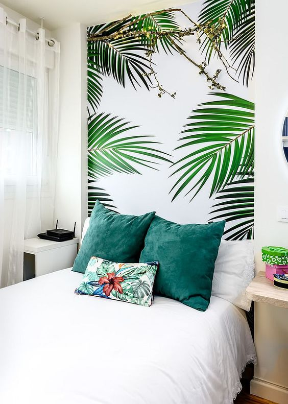 a guest bedroom with a tropical print wall that brings fun and a fresh feel to the space