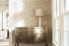 a refined shiny dresser and a 3D white butterfly circle that accents it and catches an eye