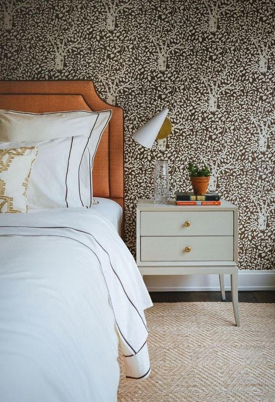 dark printed botanical wallpaper makes the bedroom more refined and interesting