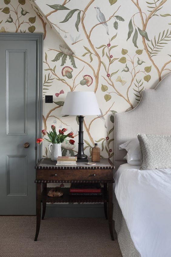floral and bird print wallpaper is a whimsical idea for a neutral or pastel bedroom