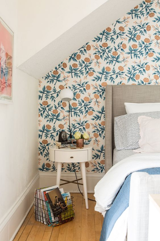 retro-inspired floral wallpaper refreshes the neutral room and makes the space bolder and more chic