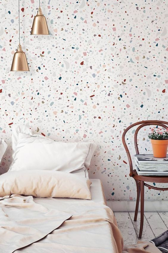terrazzo print wallpaper is a fresh and trendy idea for a bedroom, it brings an edgy feel to the space
