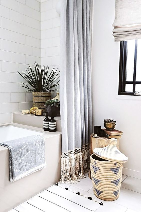 a mid-century modern boho bathroom with a basket with a lid for storage - so cool and so boho-like