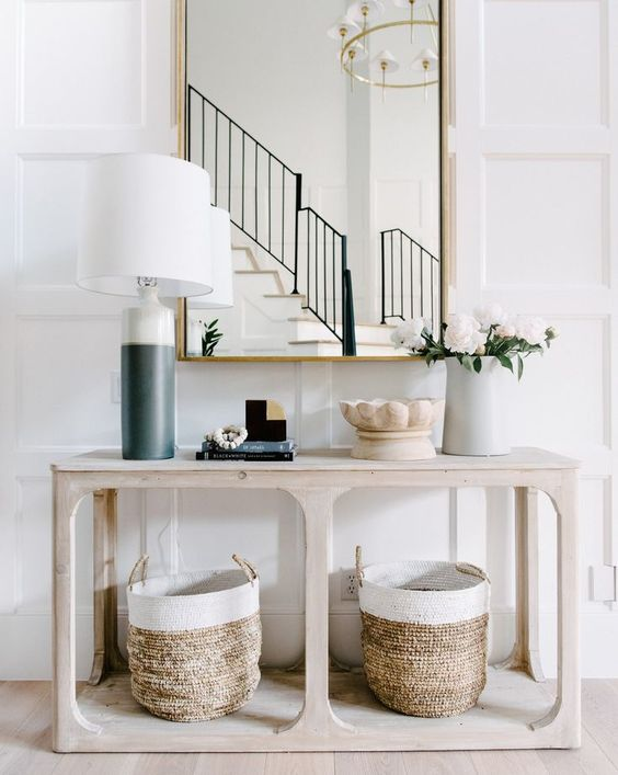 a simple wooden console table and two matching baskets for storage are very comfy and give a cozy feel to the space