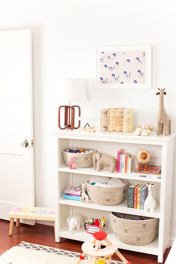 a small open dresser in white with round wicker cubbies is great for a nursery or a kid's room