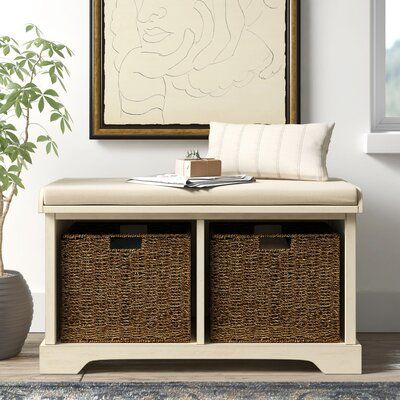 a storage bench with wicker cubbies and upholstery and a neutral pillow is ideal for an entryway