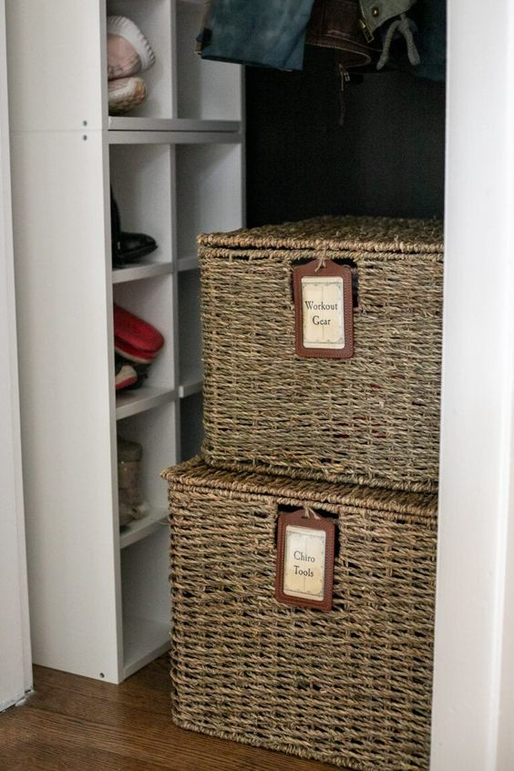 a wicker chest with tags will show off what's inside and make your closet more interesting