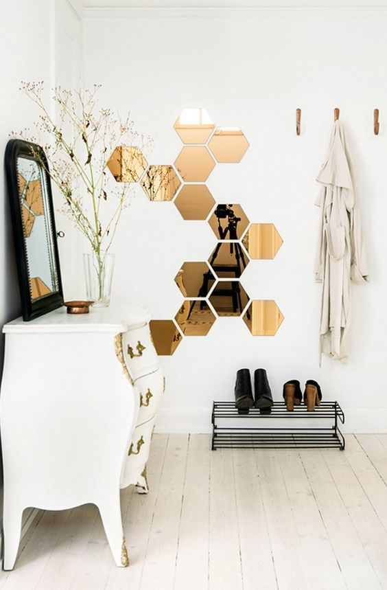 honeycomb mirrors are practical and looks beautiful in this scandinavian like hallway
