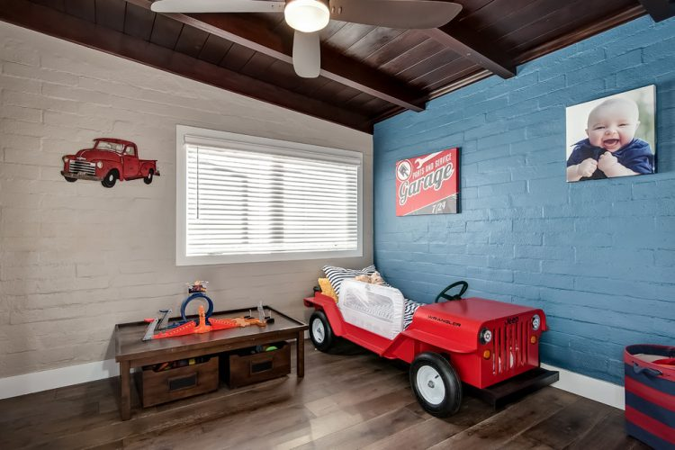 lovely red car bed for a little boy