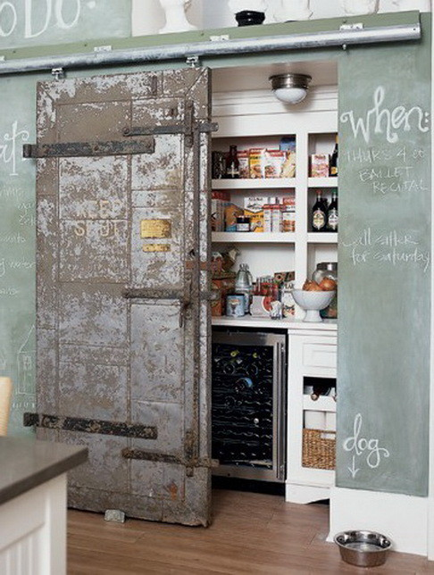 vintage sliding door could be a focal point of your kitchen while hiding your pantry
