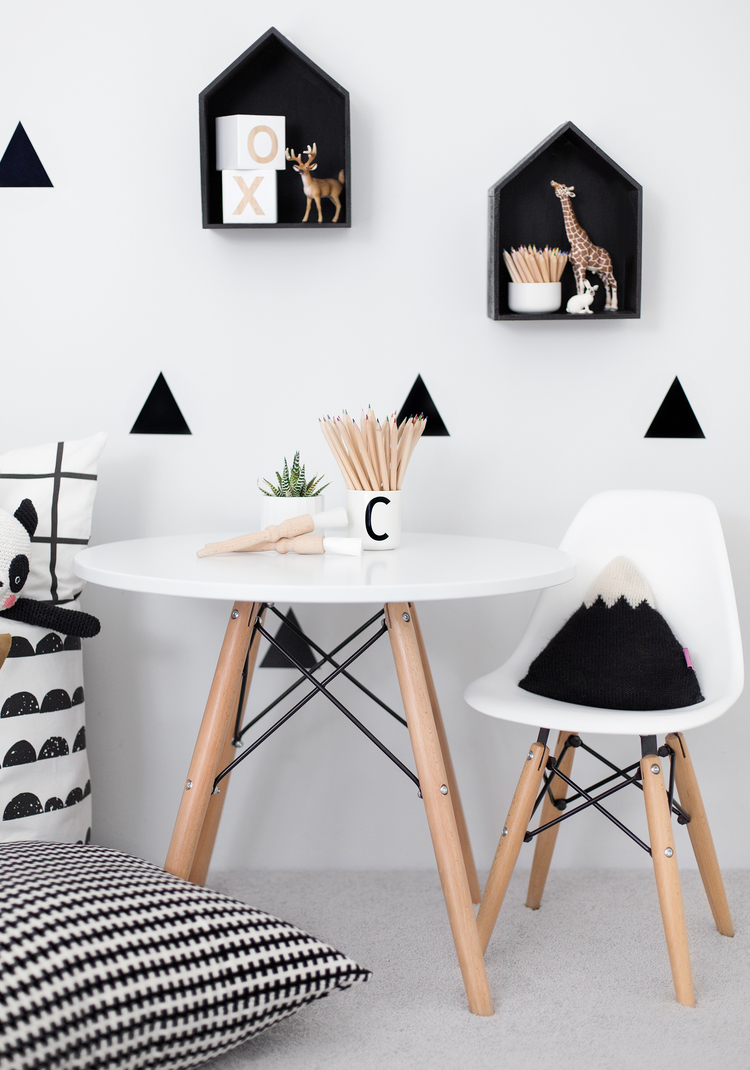 wall shelves shped like little houses are simple and good looking displays of things in a modern kids bedroom