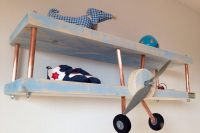 you can diy an airplane shelf for a boys room using to wood boards and copper pipes
