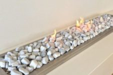 a vent free gas fireplace with pebbles looks very natural and very up-to-date at the same time