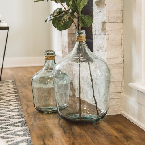 oversized bottles with twine and some green leaves by the fireplace to make the space chic and fresh