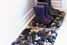 pebbles placed into the trays for shoes and boots is a cool way to add a natural feel to them and make their look cooler