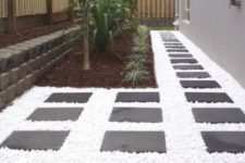 snow white pebbles plus dark tiles for creating a bold and contrasting look in the backyard ara