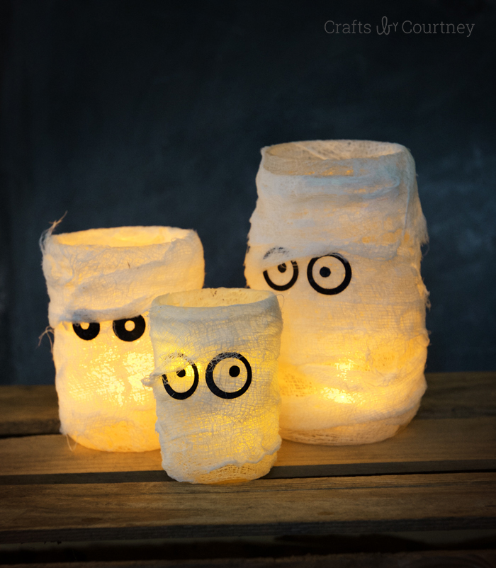 This is a very simple project to do. Simply glue cheesecloth to mason jars. Next, cut some eyes with a circle punch and glue them too. (via modpodgerocksblog.com)