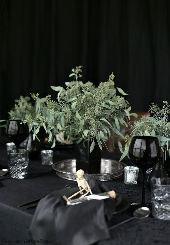 a black square vase with eucalyptus is a stylish minimalist Halloween decoration for your modern party