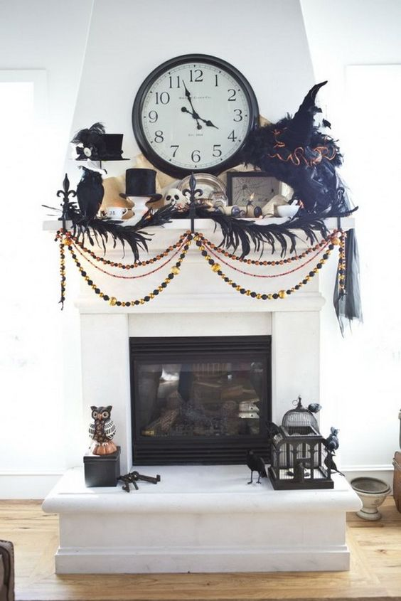 a scary old-fashioned mantel with feathers, beads, top hats, blackbirds, tassels and a large clock