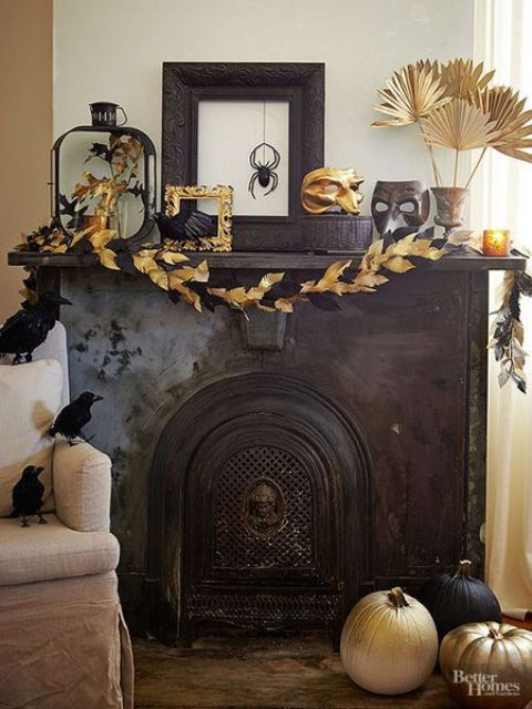 an exquisite mantel with a black and gold leaf garland, gilded fronds, frames, masks and blackbirds all around