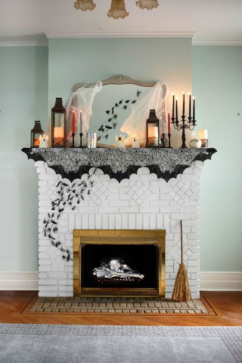 candle lanterns, colorful candles, spiderwebs, bugs going from the fireplace up and a broom