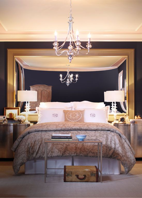 Really large mirror as a headboard in gold frame