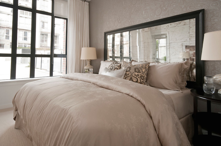 Elegant Simple mirror in a black frame as a headboard