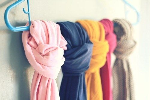 simple single coat hanger can store several scarves by knitting thme near each other