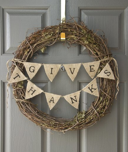 Add burlap bunting to a grapevine wreath and you got yourself a simple Thanksgiving wreath with a message.