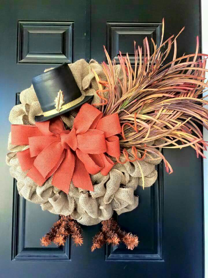 For a less traditional look add a tiny hat to your fall wreath.