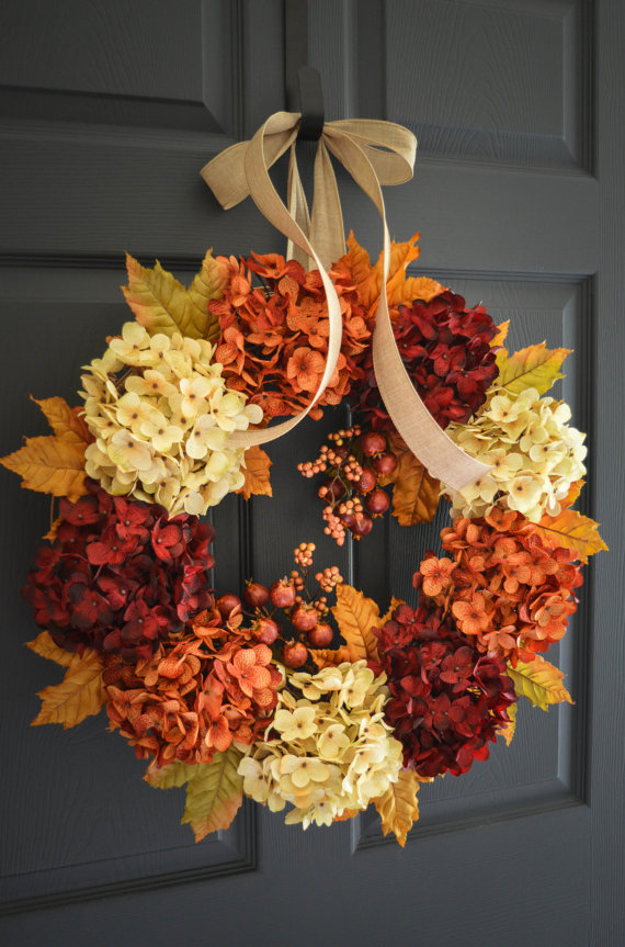 Dried hydrangeas in orange, deep red and light yellow shades glued to a wreath are perfect for Thanksgiving front door decor.