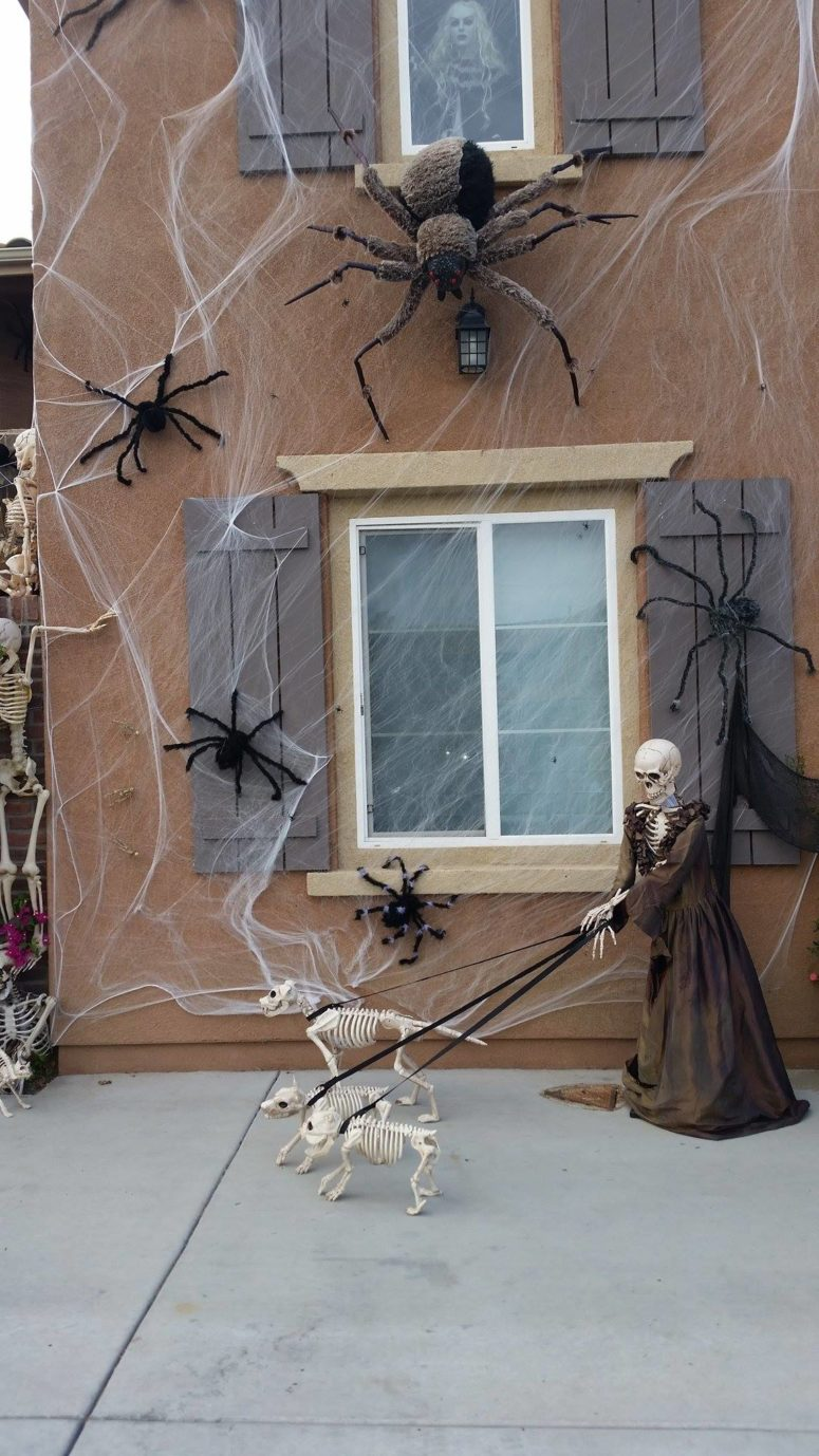 A Halloween's scene could not only be inside of the window but surround it too.