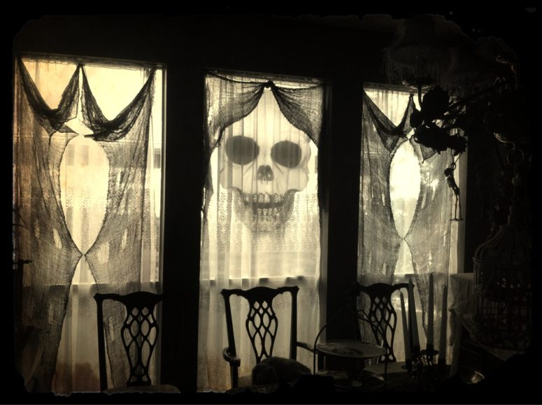 haunted clothes decorations could be used to creepify your home in an instant - Halloween Window Decor